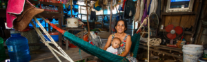 Mother holding her child on a hammock.