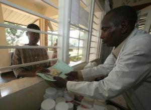 Rwandan woman receives medicine at a health centre in Rwinkwavu.