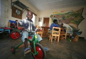 Jacques Nkurunziza playing in a waiting room of the Rwinkwayu hospital located in Rwanda.
