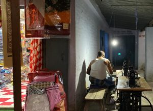 Man working in a shop at night.