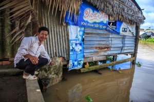 Mr. Phuong in front of his family run cafe situated on the water.
