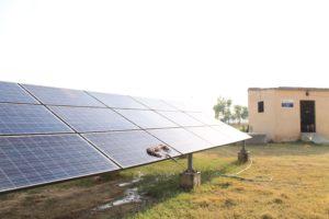 Solar paneled mini-grid in a field.
