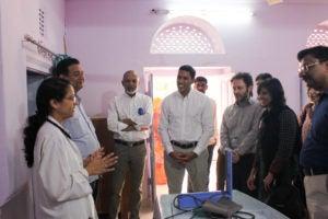 Dr. Rajiv Shah and Dr. Naveen Rao visiting a medical facility in India.
