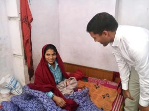 Dr. Rajiv Shah talking with a woman in India.