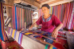 Textile worker organizing her fabrics.