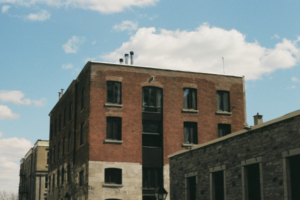 Exterior shot of an abandoned industrial building.