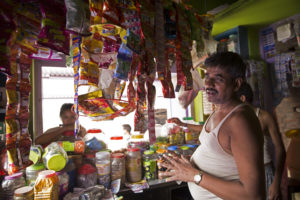 Lal Babu Prasad utilizing a solar paneled micro-grid to run his shop at Chanpatia Bihar.