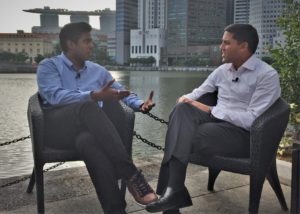 Dr. Rajiv Shah and Mohamed Abbas having a discussion by the water.