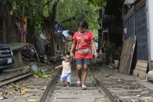 Mother and child in Khlong Toey Bangkok.