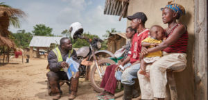Riders for Health delivering health outreach to villagers in Liberia.