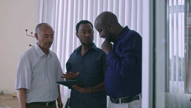 Three men in the midst of a discussion.