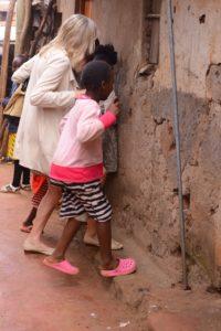 Woman and children walking through a Kibera slum.