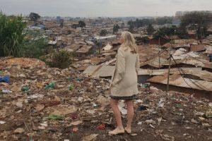 Woman touring a Kibera slum.