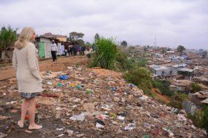 Woman viewing a Kibera slum.
