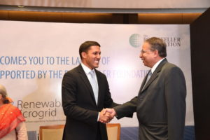 The Rockefeller Foundation President Dr. Rajiv Shah shaking hands with Praveer Sinha, CEO of Tata Power.