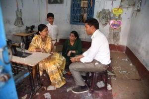 Dr. Rajiv Shah visiting Ruby Kumari at her sewing center.