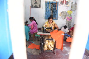 Girl working at Ruby Kumar's Sewing Center.