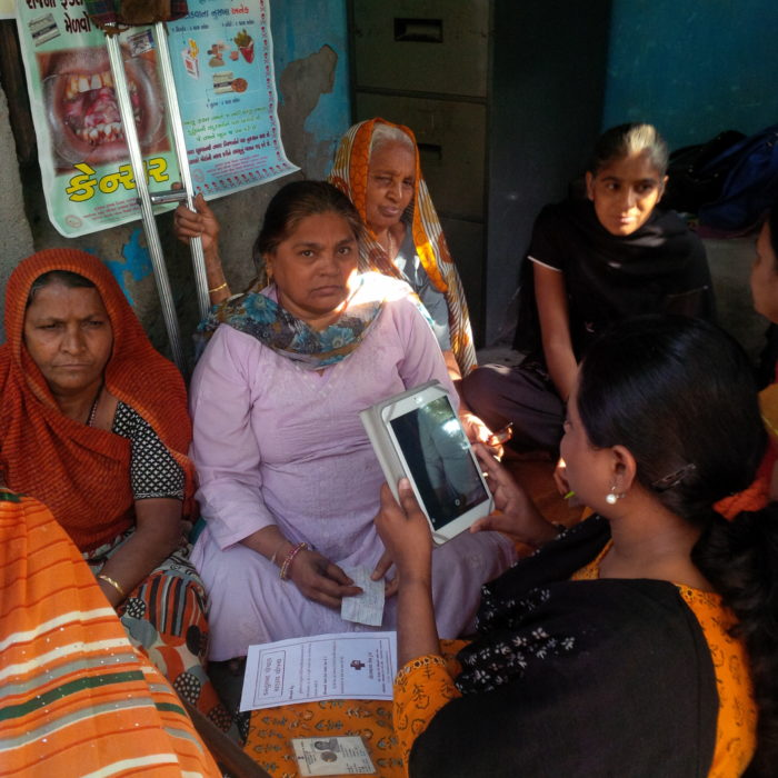 Women listening to a healthcare presentation.