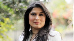 Photo of Sharmeen Obaid Chinoy in a garden.