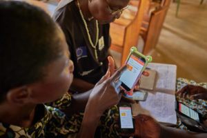 data.org providing health information to a patient in Africa.