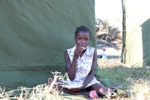 Cyclone Idai survivor eating a hot meal provided by World Kitchen.