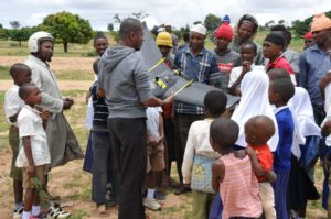 WeRobotics personnel conducting a drone demonstration for children in Tanzania.