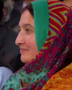 Mother wearing a headscarf.