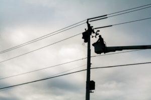 Man working on a powerline.