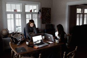 Women at work on their laptops.