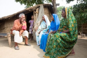 Community mobiliser Mahendra Pasawan talking with women at a village in India.
