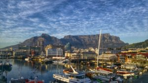 Boats docked at a cape town.