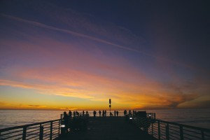 View of a pier at sunset.