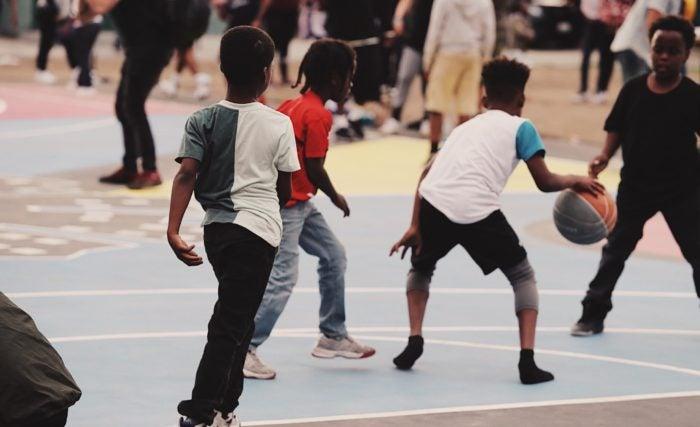 Neighborhood children playing basketball.