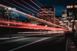 city road with blurred streaks of car lights