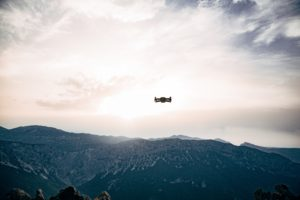 Drone flying over a mountain range.