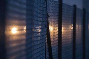 Wired fence at night.
