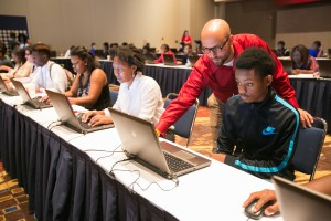 Youth filling out job applications at Opportunity Fair and Forum in Chicago.