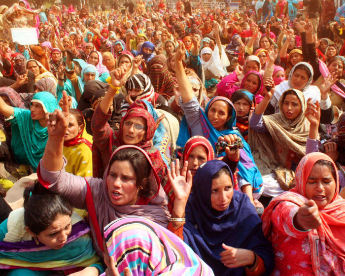 Female protesters crowded together.