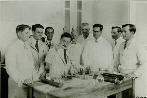 Dr. Hideyo Noguchi surrounded by other doctros.