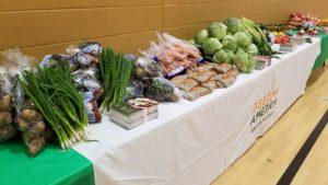 Produce spread across a Feeding America table.
