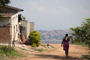Woman walking down a dirt road.