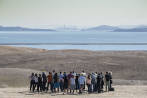 Group of people looking out over the Bay Area.